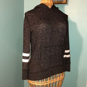Black sweater with 2 white stripes on each sleeve.